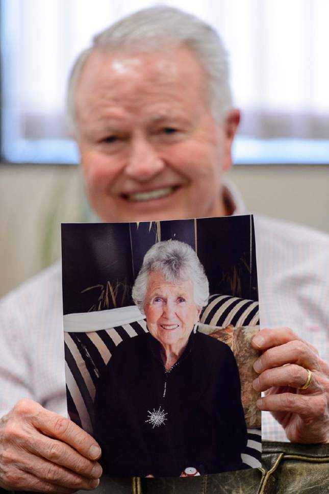 Trent Nelson  |  The Salt Lake Tribune Pat King holds a picture of his mother, Geraldine E. King on Friday. Pat King  is donating $4 million to help build one of four new homeless shelters.