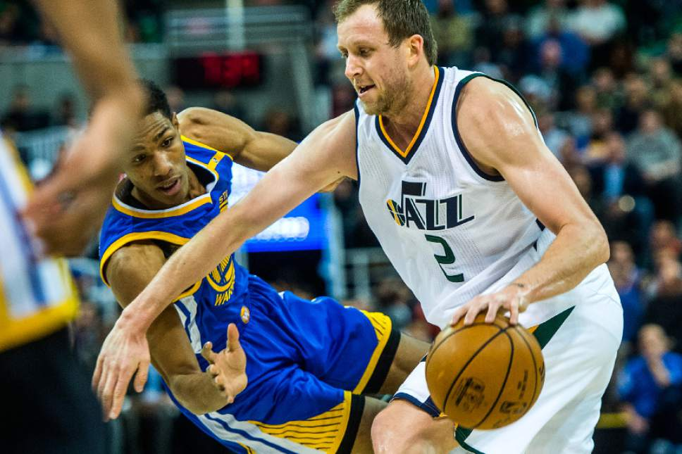 Chris Detrick  |  The Salt Lake Tribune Golden State Warriors guard Patrick McCaw (0) guards Utah Jazz forward Joe Ingles (2) during the game at Vivint Smart Home Arena Thursday December 8, 2016.