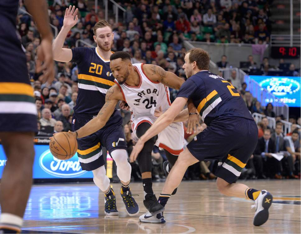 Scott Sommerdorf   |  The Salt Lake Tribune   Toronto Raptors guard Norman Powell (24) tries to split the defense of Utah Jazz forward Gordon Hayward (20), left, and Utah Jazz forward Joe Ingles (2) during second half play. The Toronto Raptors beat the Jazz 104-98, Friday, December 23, 2016.