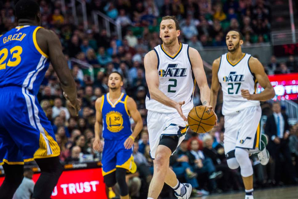Chris Detrick  |  The Salt Lake Tribune Utah Jazz forward Joe Ingles (2) runs past Golden State Warriors forward Draymond Green (23) during the game at Vivint Smart Home Arena Thursday December 8, 2016.