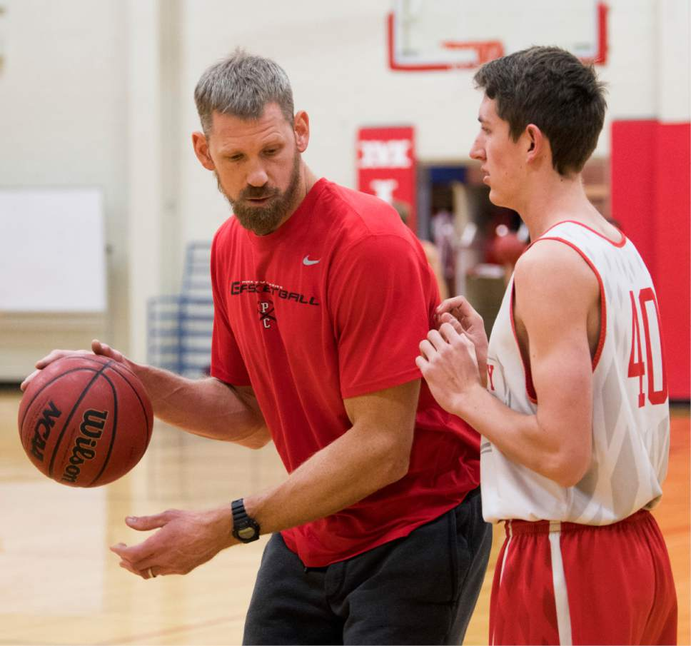 Rick Egan  |  The Salt Lake Tribune  Mike Doleac, former Ute basketball star and NBA veteran, works with Alex Obradovich, as the head coach of the Park City Miners basketball team, during practice, Monday, December 19, 2016.