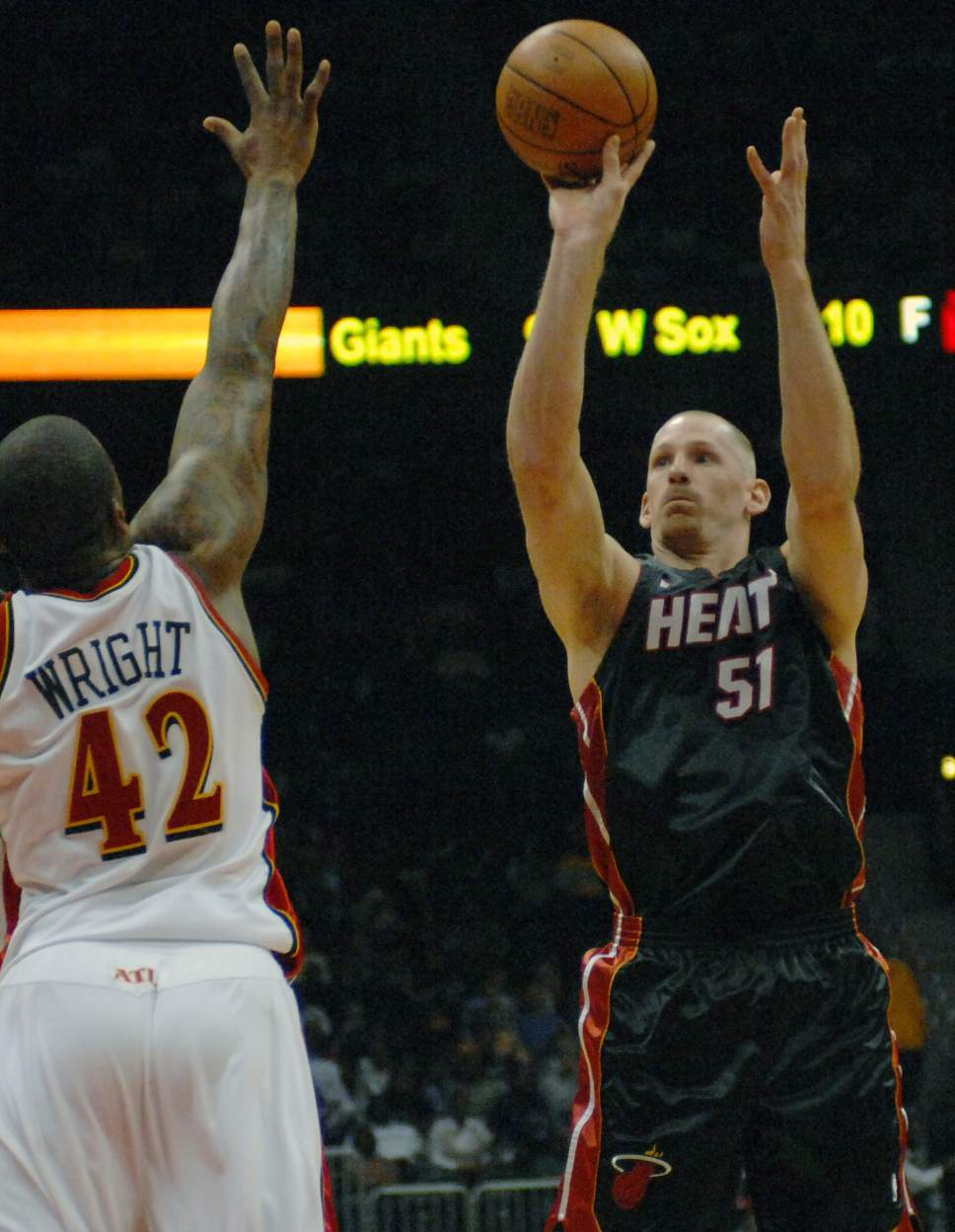 Miami Heat center Michael Doleac (51) takes a shot against Atlanta Hawks' Lorenzen Wright during the first quarter of an NBA basketball game, Wednesday, March 21,  2007, in Atlanta. (AP Photo/Gregory Smith)