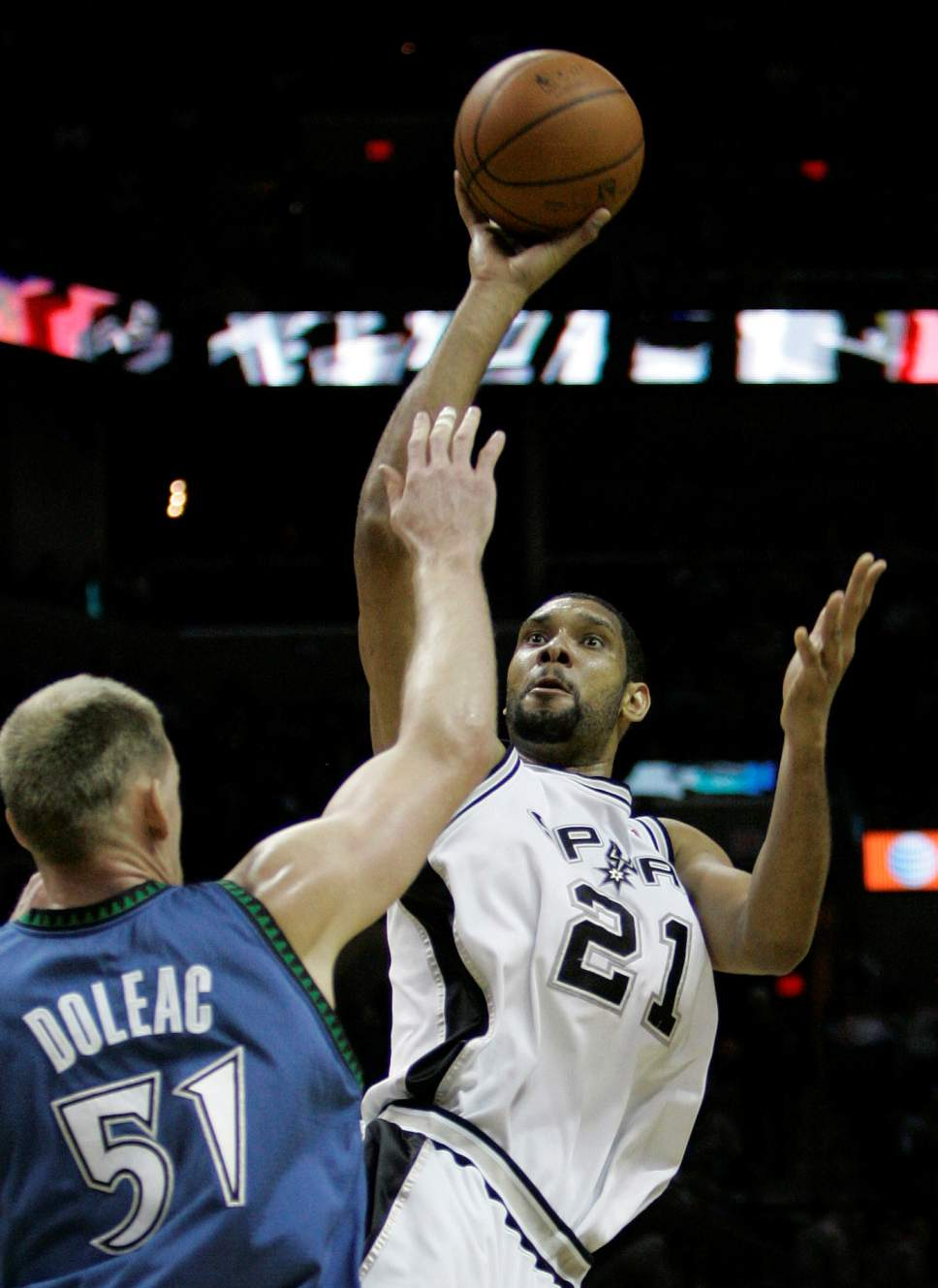 San Antonio Spurs forward Tim Duncan (21) shoots over Minnesota Timberwolves  center Michael Doleac (51) during the third quarter of their NBA basketball game in San Antonio, Saturday, Jan. 12, 2008. San Antonio won 105-88.  (AP Photo/Eric Gay)