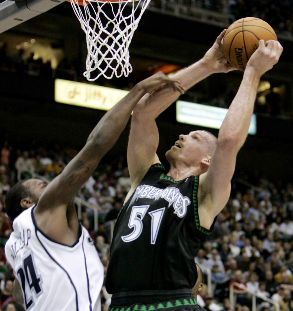 Minnesota Timberwolves center Michael Doleac (51) is fouled by Utah Jazz forward Paul Millsap (24) during the fourth quarter of an NBA basketball game Wednesday, April 2, 2008, in Salt Lake City. The Jazz beat the Timberwolves 117-100. (AP Photo/Douglas C. Pizac)