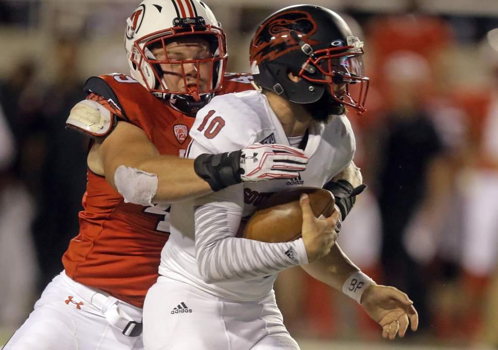 Utah defensive end Hunter Dimick, left, sacks Southern Utah quarterback Tannon Pedersen (10) during the second half during an NCAA college football game Thursday, Sept. 1, 2016, in Salt Lake City. Utah won 24-0. (AP Photo/Rick Bowmer)