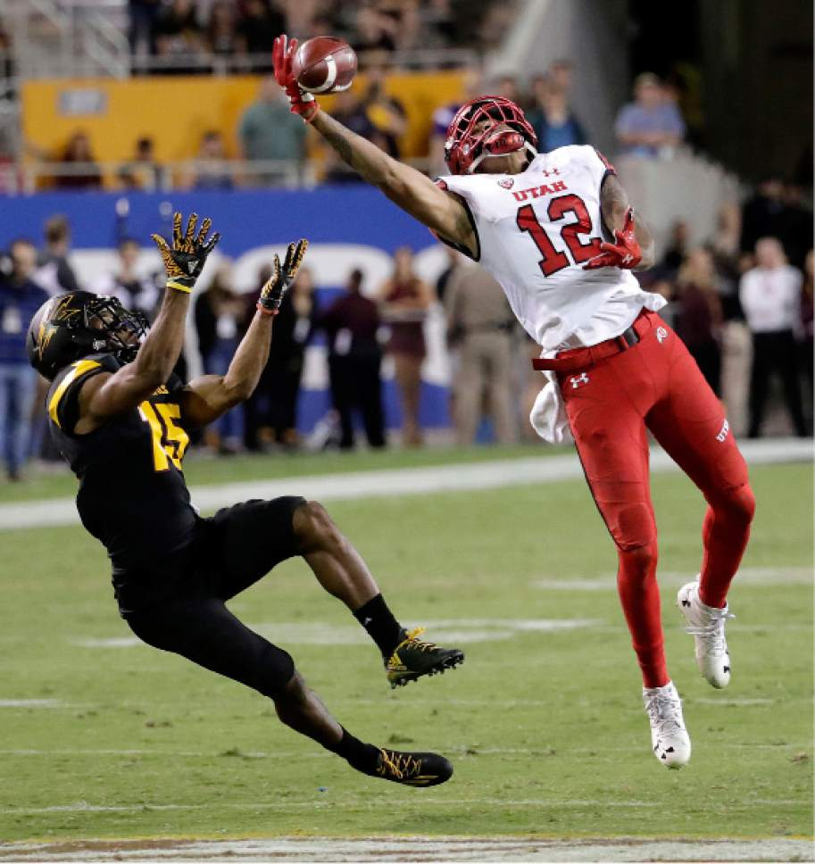 Utah wide receiver Tim Patrick (12) can't make the catch against Arizona State defensive back Bryson Echols (15) during the second half of an NCAA college football game, Thursday, Nov. 10, 2016, in Tempe, Ariz. (AP Photo/Matt York)