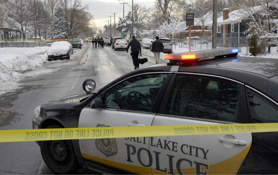 Al Hartmann  |  The Salt Lake Tribune Salt Lake City Police investigate homicide scene at 300 East Browning Street in Salt Lake City Tuesday Dec. 27.  Shots were fired just after 11 a.m. and a body was found in a car at the scene.  Police are on the lookout for two men believed to be involved in the shooting. They are still at large.