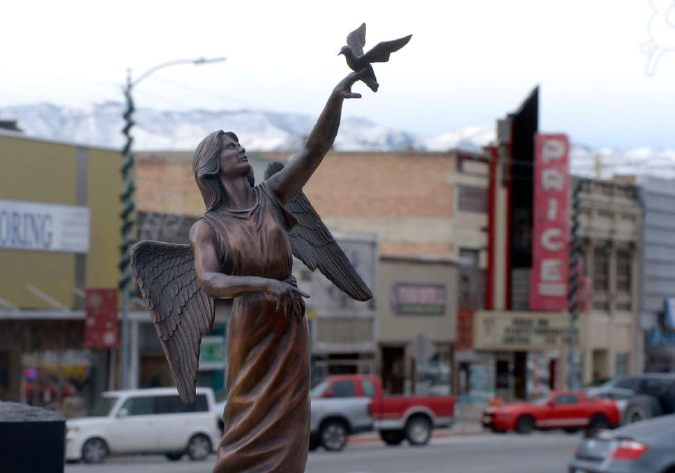 Al Hartmann  |  The Salt Lake Tribune Angel and dove statue of the Coal Miner Memorial is placed prominently in the center of Price's Main street.   Businesses have suffered in the past few years with the closing of local mines and low demand for coal.  With the election of Donald Trump people in Carbon and Emery Counties breathed a sigh of relief and are hopeful that the coal industry can be saved.
