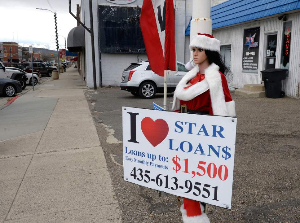 Al Hartmann  |  The Salt Lake Tribune Christmas mannequin advertises short term loans on Price's Main Street.   Businesses and people have suffered in the past few years with the closing of local mines and low demand for coal.  With the election of Donald Trump people in Carbon and Emery Counties breathed a sigh of relief and are hopeful that the coal industry can be saved.
