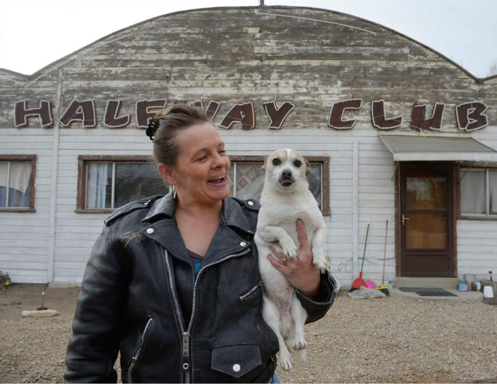 "Al Hartmann  |  The Salt Lake Tribune With the election of Donald Trump people in Carbon and Emery County breathed a sigh of relief and are hopeful that the coal industry can be saved.  Shelly Marvidikis with her dog ""Baby Boy"" work outside an old roadhouse in Carbonville she is renting.  Her dislike of Hillary Clinton drove her to vote for Trump and she support his ideas to bring back coal."