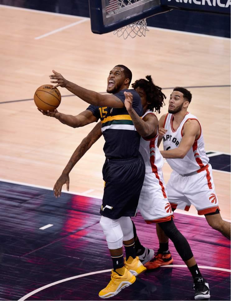 Scott Sommerdorf   |  The Salt Lake Tribune   Utah Jazz forward Derrick Favors (15) goes to the basket during first half play as the Toronto Raptors led the Jazz 56-51 at the half, Friday, December 23, 2016.
