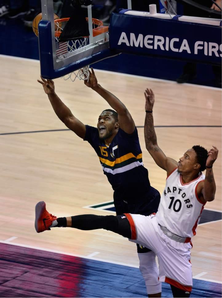 Scott Sommerdorf   |  The Salt Lake Tribune   Utah Jazz forward Derrick Favors (15) yells as he goes to the basket against Toronto Raptors guard DeMar DeRozan (10) during first half play as the Toronto Raptors led the Jazz 56-51 at the half, Friday, December 23, 2016.