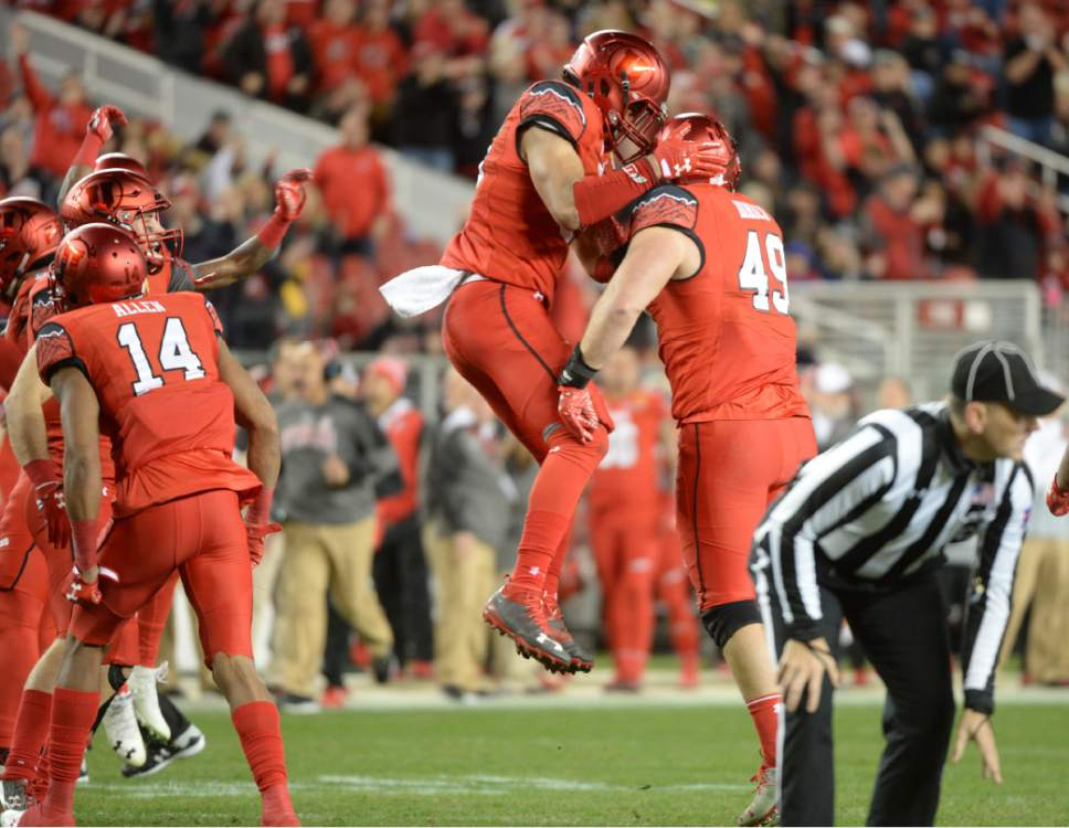 Steve Griffin / The Salt Lake Tribune  Utah Utes defensive end Hunter Dimick (49) gets mobbed  after recovering a fumble after Utah Utes defensive end Pita Taumoepenu (50) strips the ball from Indiana Hoosiers quarterback Richard Lagow (21) during the Foster Farms Bowl at Levi's Stadium in Santa Clara California  Wednesday December 28, 2016.