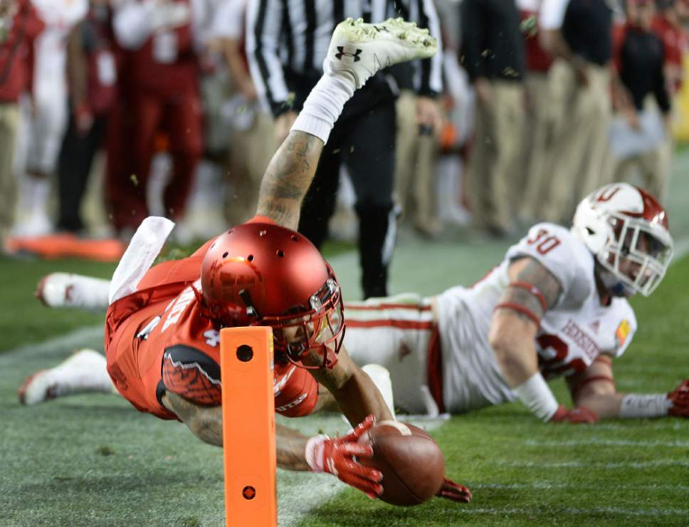 Steve Griffin / The Salt Lake Tribune  Utah Utes running back Troy McCormick (4) dives for the end zone as he stretches with the ball as Indiana Hoosiers defensive back Chase Dutra (30) falls to the ground during the Foster Farms Bowl at Levi's Stadium in Santa Clara California  Wednesday December 28, 2016.
