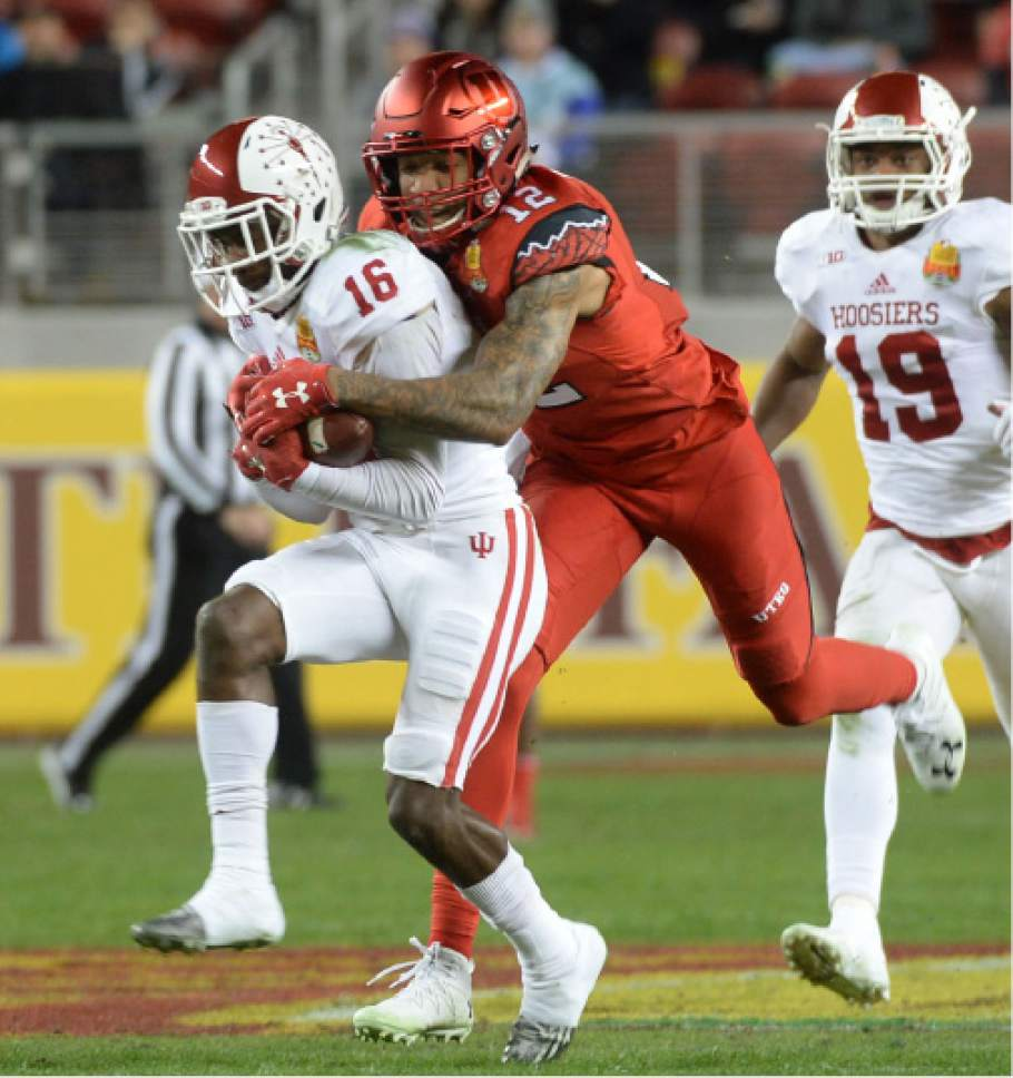 Steve Griffin / The Salt Lake Tribune  Utah Utes wide receiver Tim Patrick (12)***Utah Utes defensive back Justin Thomas (12) is forced to tackle Indiana Hoosiers defensive back Rashard Fant after Fant intercepted a pass during the Foster Farms Bowl at Levi's Stadium in Santa Clara California  Wednesday December 28, 2016.