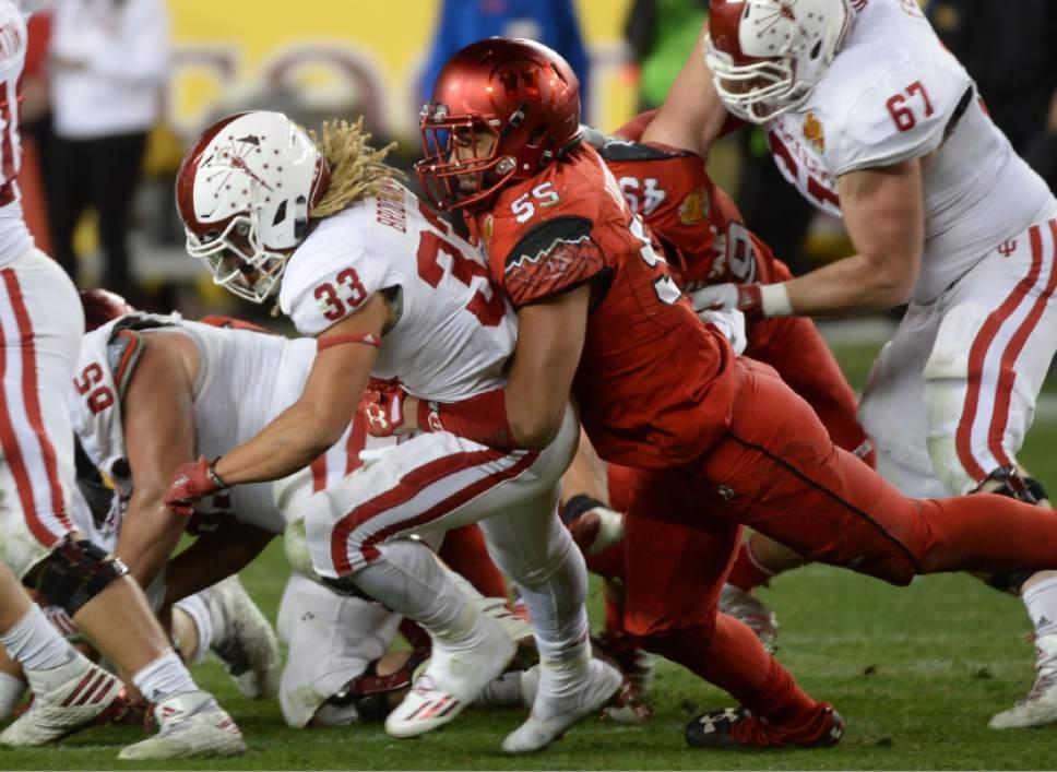 Steve Griffin / The Salt Lake Tribune  Utah Utes linebacker Kavika Luafatasaga (55) brings down Indiana Hoosiers running back Ricky Brookins (33) for a loss during the Foster Farms Bowl at Levi's Stadium in Santa Clara California  Wednesday December 28, 2016.