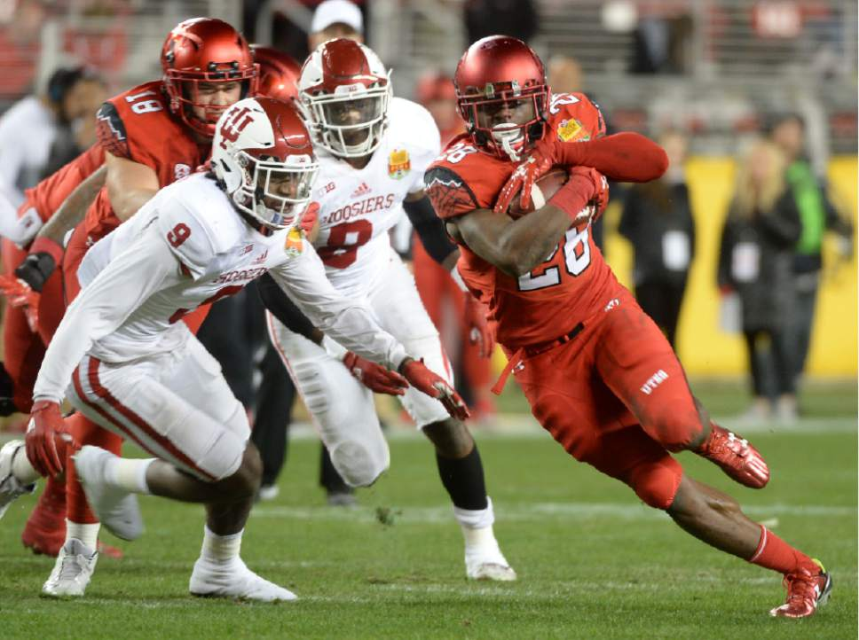 Steve Griffin / The Salt Lake Tribune  Utah Utes running back Joe Williams (28) heads up field as he gets free during the Foster Farms Bowl at Levi's Stadium in Santa Clara California  Wednesday December 28, 2016.