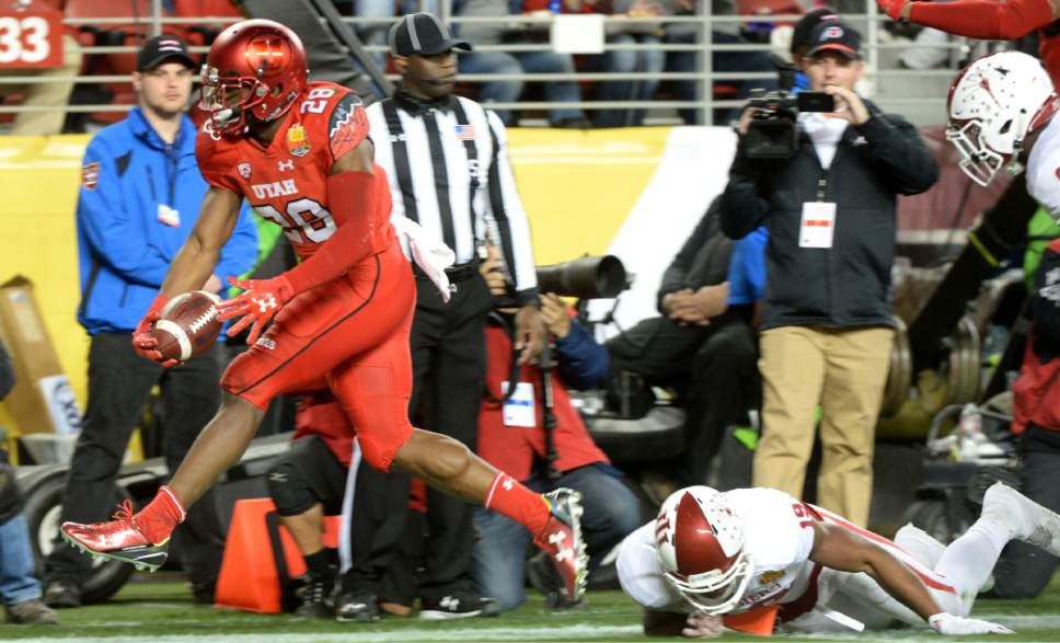 Steve Griffin / The Salt Lake Tribune  Utah Utes running back Joe Williams (28) stretches for a touchdown during the Foster Farms Bowl at Levi's Stadium in Santa Clara California  Wednesday December 28, 2016.