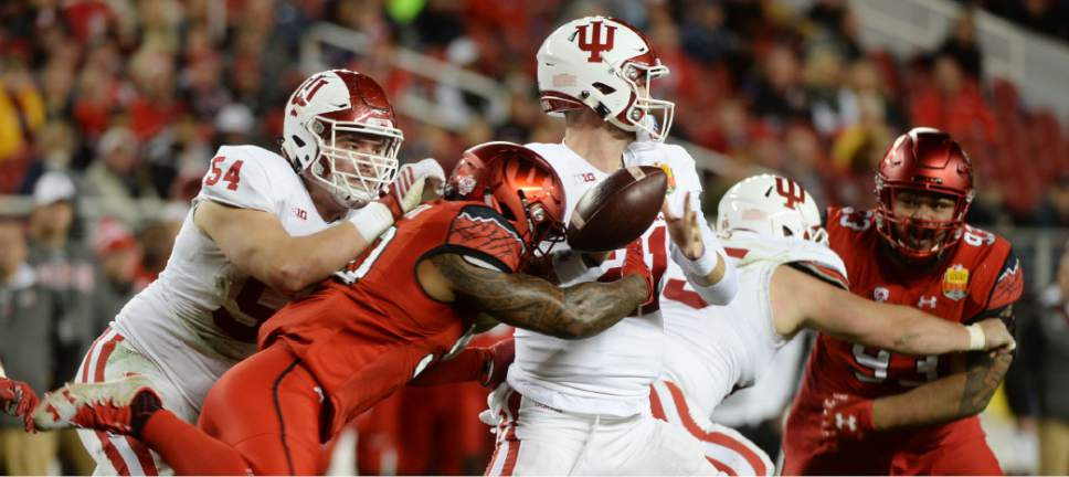 Steve Griffin / The Salt Lake Tribune  Utah Utes defensive end Pita Taumoepenu (50) strips the ball from Indiana Hoosiers quarterback Richard Lagow (21) during the Foster Farms Bowl at Levi's Stadium in Santa Clara California  Wednesday December 28, 2016. The ball was recovered by Utah Utes defensive end Hunter Dimick (49) on the play.