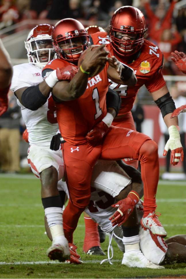 Steve Griffin / The Salt Lake Tribune  Utah Utes quarterback Tyler Huntley (1)powers his way into the end zone during the Foster Farms Bowl at Levi's Stadium in Santa Clara California  Wednesday December 28, 2016.