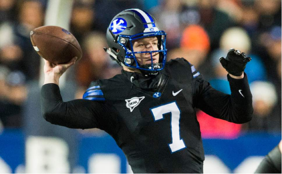 BYU quarterback Taysom Hill (7) throws the ball during an NCAA college football game against Utah State in Provo, Utah, Saturday, Nov. 26, 2016. (Rick Egan/The Salt Lake Tribune via AP)