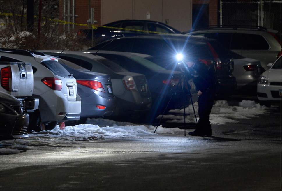 Scott Sommerdorf   |  The Salt Lake Tribune   A photographer working for the SLC Crime Lab takes photos of the shooting scene in the parking lot of ARUP, 500 Chipeta Way, at the University of Utah on Thursday, December 29, 2016.