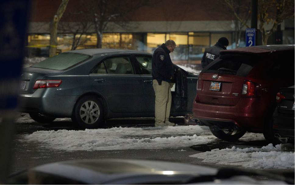 Scott Sommerdorf  |  The Salt Lake Tribune   Police investigate a fatal shooting that took place next to this sedan in the parking lot of ARUP, 500 Chipeta Way, at the University of Utah on Thursday, December 29, 2016.