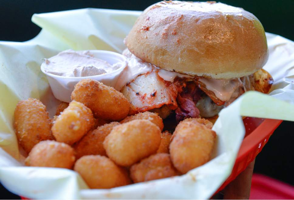 Francisco Kjolseth | The Salt Lake Tribune  Chedda Burger's The Silly Round Eye, featuring beef patty, Swiss, pastrami, kimchi and fry sauce with Chedda tots.