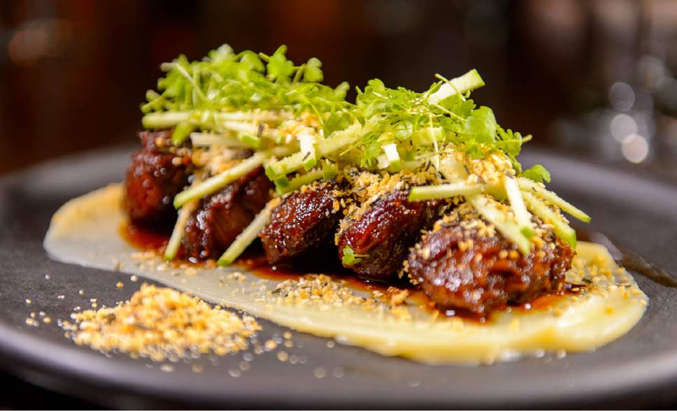 Trent Nelson  |  The Salt Lake Tribune Whiskey glazed pork cheeks with parsnip puree at Tupelo in Park City.