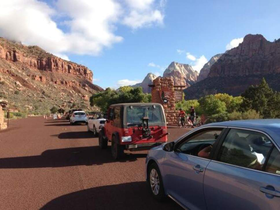 Jim Dalrymple  |  Tribune file photo A line of cars waits to enter Zion National Park in  2013. Winter visitation has increased nearly 70 percent  causing officials to turn some visitors away.