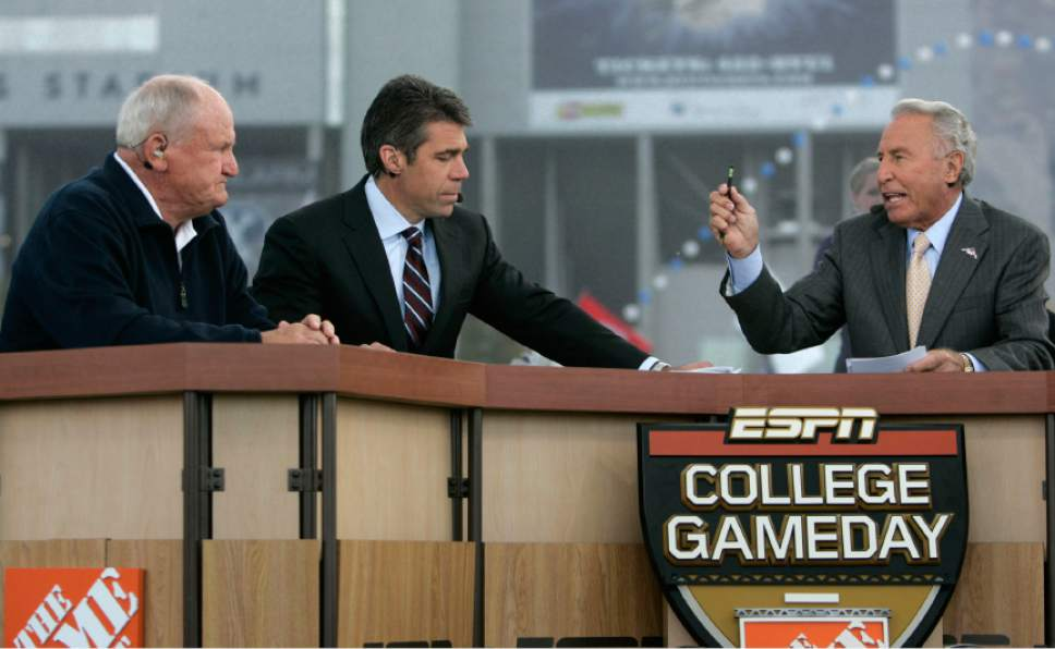 |  Tribune File Photo  Former BYU football coach LaVell Edwards, left, and ESPN's Chris Fowler, center, and ESPN's Lee Corso talk during a broadcast of ESPN's College GameDay pregame show Saturday, October 24 2009 next to LaVell Edwards Stadium at Brigham Young University in Provo. Hundreds of college football fans turned out for the airing of ESPN's College GameDay pregame show prior to the BYU-TCU matchup where host Lee Corso picked the winner to be TCU.