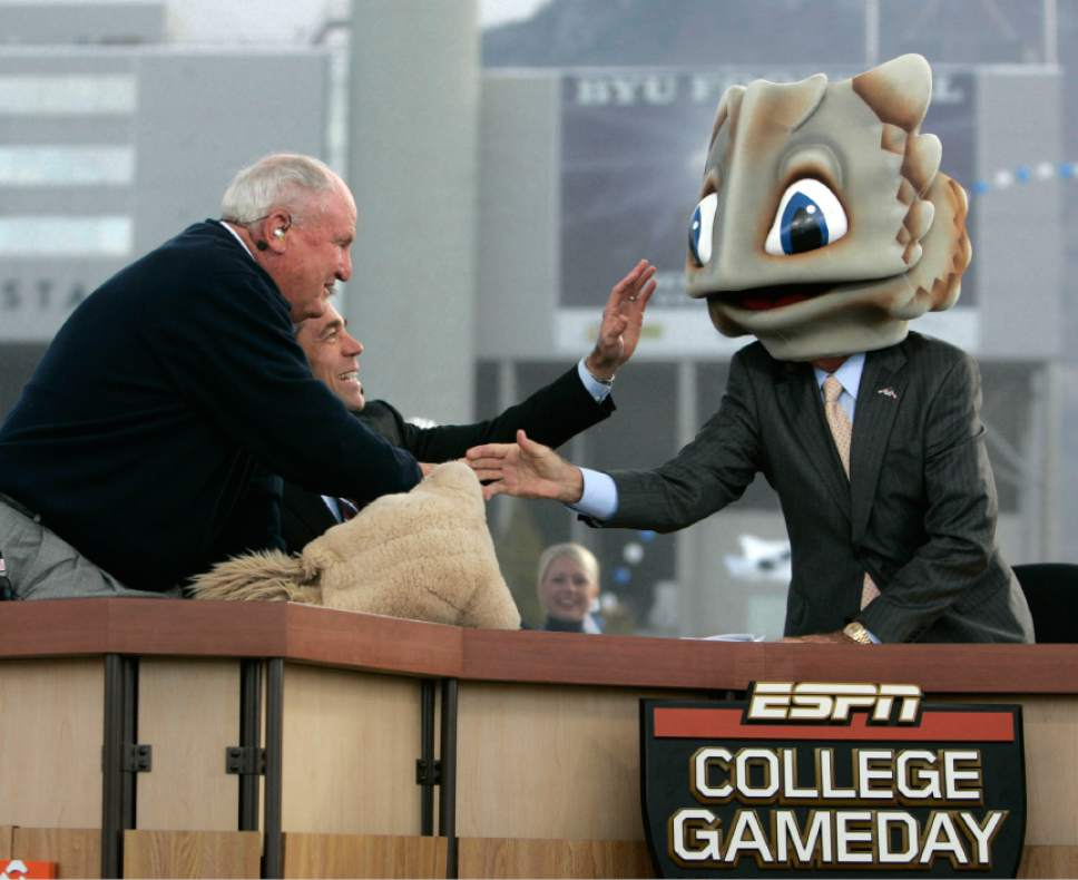 |  Tribune File Photo  Former BYU football coach LaVell Edwards, left, and ESPN's Chris Fowler, center, and ESPN's Lee Corso joke as Corso puts on a frog's head to note his game prediction during a broadcast of ESPN's College GameDay pregame show Saturday, October 24 2009 next to LaVell Edwards Stadium at Brigham Young University in Provo. Hundreds of college football fans turned out for the airing of ESPN's College GameDay pregame show prior to the BYU-TCU matchup where host Lee Corso picked the winner to be TCU.