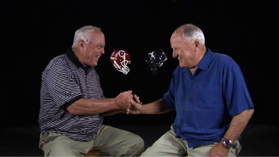 "Courtesy  |  KUED  Former Utah coach Ron McBride, left, and BYU coach LaVell Edwards wrangle in KUED's new documentary ""Red Blood, Blue Blood,"" a history of the Utah-BYU football rivalry."