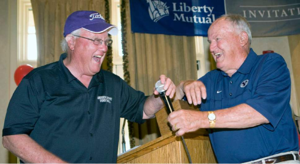 Al Hartmann  |  The Salt Lake Tribune  Former Utah football coach and now Weber State University Coach Ron McBride, left, trades barbs with his old friend former BYU Coach LaVell Edwards at the Liberty Mutual Invitational BYU-Utah golf outing at the Salt Lake Country Club Monday June 6, 2011.