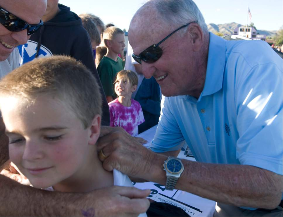 Rick Egan  | The Salt Lake Tribune   Former BYU coach Lavell Edwards signs Mathew Taylor's shirt, before the Mascot bowl at Lehi High, Monday, September 30, 2013.