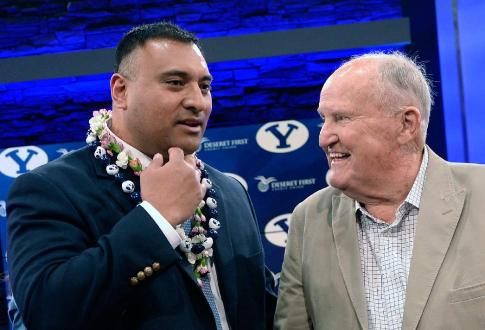 Al Hartmann  |  The Salt Lake Tribune  BYU's new head coach Kalani Sitaki talks with his old head coach Lavell Edwards after a press conference in Provo Monday Dec. 21, 2015.