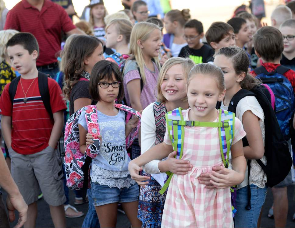 Al Hartmann  |  The Salt Lake Tribune Students line up by classroom and old classmates meet again at the brand new Butler Elementary in Cotonwood Heights Wenesday March 25.  It is one of hundreds of schools that opened Wednesday as students gear up for the 2016-2017 school year.