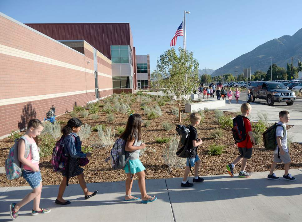 Al Hartmann  |  The Salt Lake Tribune Students line up by classroom and march together to enter the brand new Butler Elementary in Cotonwood Heights Wenesday March 25.  It is one of hundreds of schools that opened Wednesday as students gear up for the 2016-2017 school year.