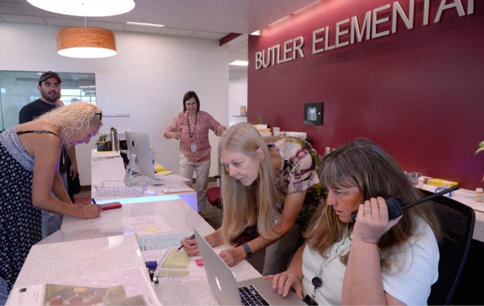 Al Hartmann  |  The Salt Lake Tribune Office secretaries deal with dozens of last minute details at the brand new Butler Elementary in Cotonwood Heights Wenesday March 25.  It is one of hundreds of schools that opened Wednesday as students gear up for the 2016-2017 school year.