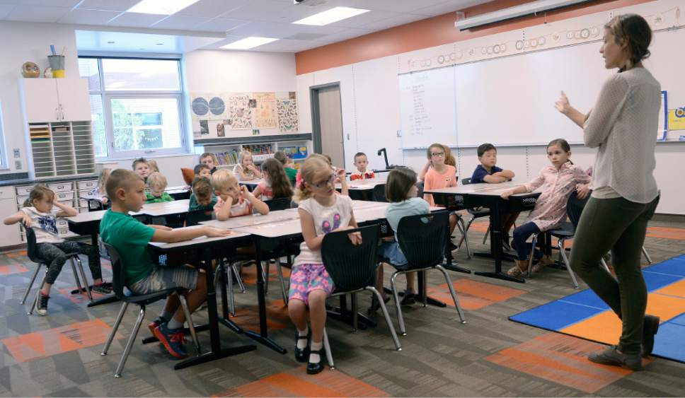 Al Hartmann  |  The Salt Lake Tribune First year teacher Jane Hart goes over some basic rules for her first graders at the brand new Butler Elementary in Cotonwood Heights Wenesday March 25.  It is one of hundreds of schools that opened Wednesday as students gear up for the 2016-2017 school year.