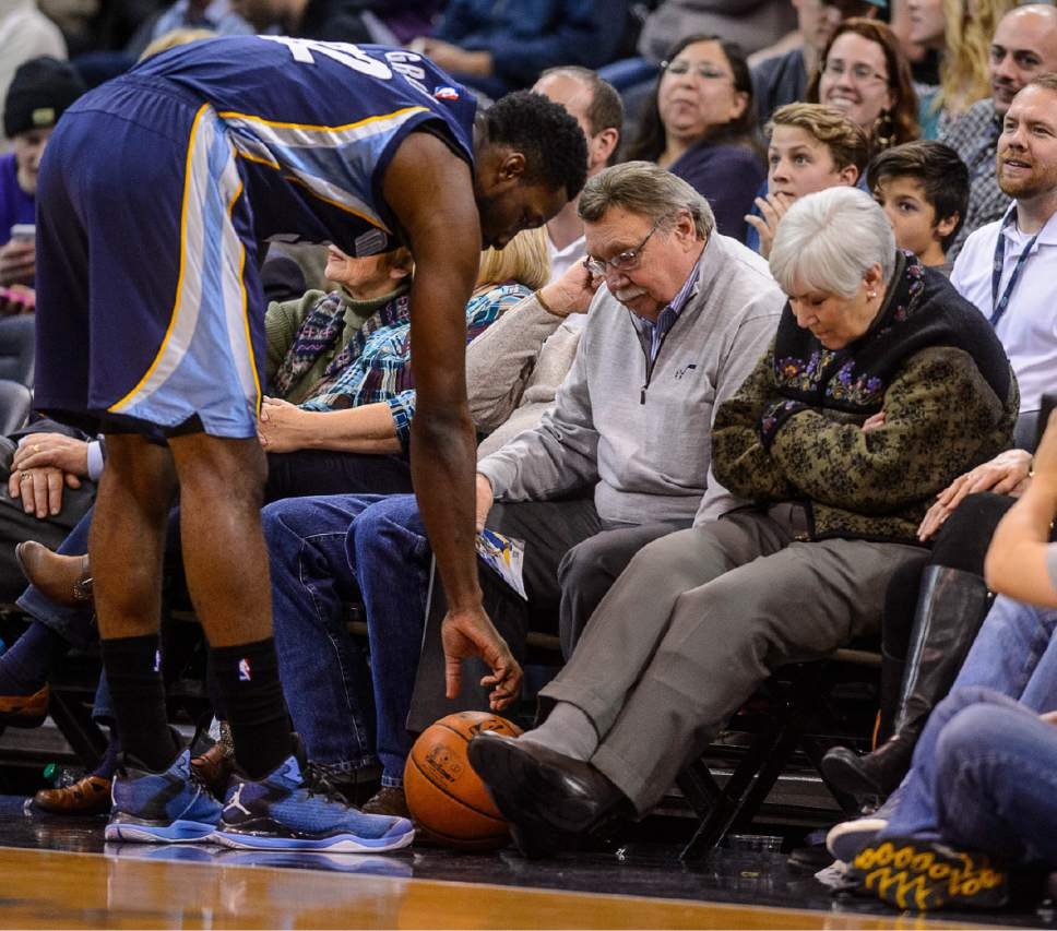 Trent Nelson  |  The Salt Lake Tribune Memphis Grizzlies forward Jeff Green (32) reaches down for a ball that rolled under the seat of Gail Miller, as the Utah Jazz host the Memphis Grizzlies, NBA basketball at EnergySolutions Arena in Salt Lake City, Wednesday February 4, 2015. Kim Wilson at left.