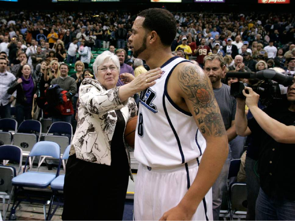 Utah Jazz guard Deron Williams (8) presents Gail Miller with the ball after their game against New Orleans Saturday, February 21, 2009 at EnergySolutions Arena in Salt Lake City.  Gail's husband Larry H. Miller passed away the day before from complications from Type 2 Diabetes. The Jazz defeated the Hornets 102 to 88. Jim Urquhart/The Salt Lake Tribune; 2/21/09