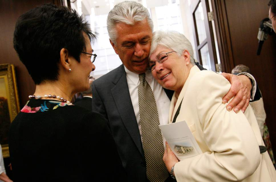 President Dieter F. Uchtdorf  hugs Gail Miller, the wife of the late Utah Jazz owner Larry Miller after the ceremony. Harriet Reich Uchtdorf is at left. The Church of Jesus Christ of Latter-Day Saints church History Library dedication on Saturday.  Photo by Leah Hogsten/ The Salt Lake Tribune SLC [date} SLC