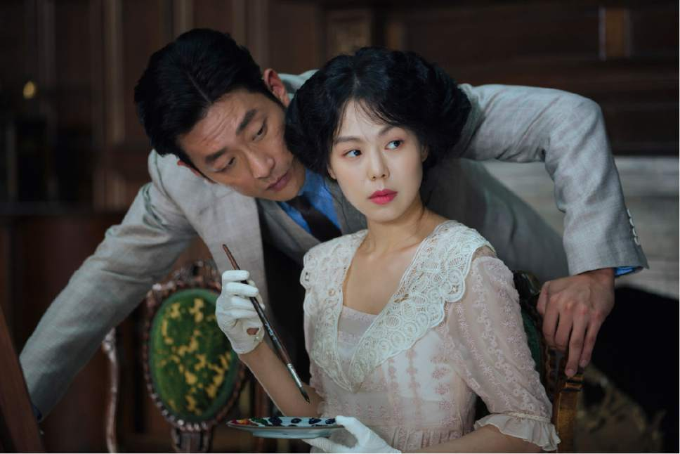 "The Count (Ha Jung-woo, left) makes his move to seduce the wealthy Hideko (Kim Min-hee), in the Korean thriller ""The Handmaiden."" Courtesy Magnolia Pictures"