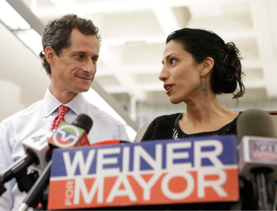 FILE - In this July 23, 2013 file photo, Huma Abedin, alongside her husband, then-New York mayoral candidate Anthony Weiner, speaks during a news conference in New York.  (AP Photo/Kathy Willens, File)