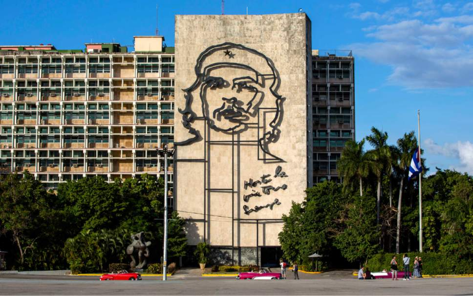"FILE - This Nov. 27, 2016 file photo shows the iconic image of Cuba's revolutionary hero Ernesto ""Che"" Guevara, at Revolution Square near the Ministry of Interior in Havana, Cuba. Some Americans may rush to see Cuba in 2017, worried that the Trump administration will tighten travel rules. Others may postpone plans until they see what the new administration does. (AP Photo/Desmond Boylan, File)"