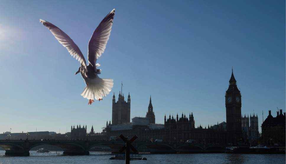FILE - This Nov. 29, 2016 file photo shows seagulls waiting for tourists to feed them on the South Bank of the River Thames,  in London. Currency changes in the wake of Brexit has made the United Kingdom a little more affordable for some international travelers. (AP Photo/Alastair Grant, File)