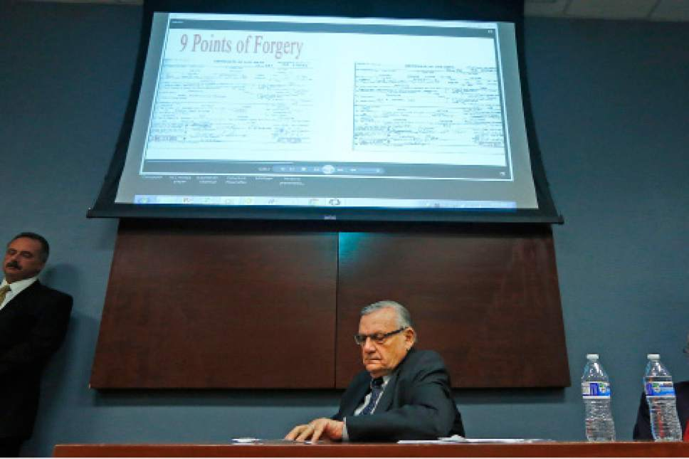 FILE - In this Dec. 15, 2016, file photo, Maricopa County Sheriff Joe Arpaio listens to a video presentation of the findings from a five-year investigation into the authenticity of President Barack Obama's birth certificate during a news conference in Phoenix. Arpaio has left office with a mixed legacy on immigration, jails and other key issues. Critics accused him of being a publicity-driven bully who treated powerless people harshly because it was popular with voters. His supporters counter that he's a standup guy who did what the public wanted and was the only local police official in Arizona to move against illegal immigration. (AP Photo/Ross D. Franklin, File)