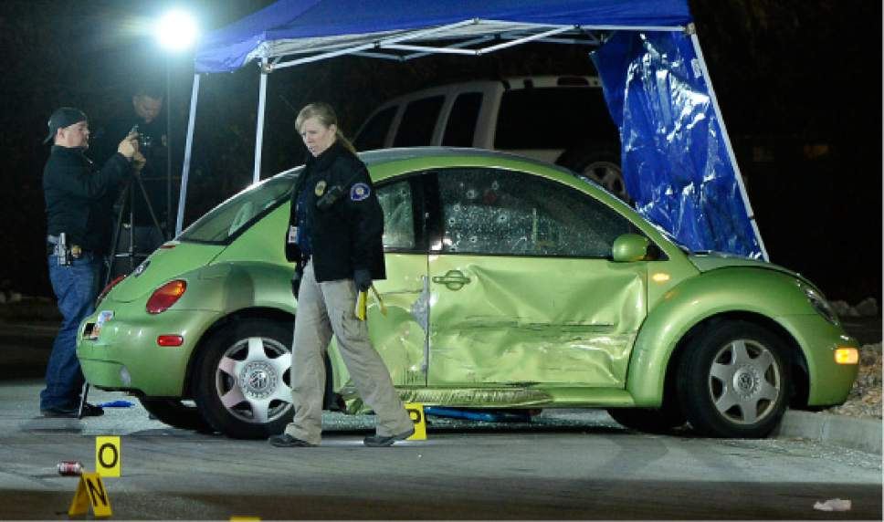 Francisco Kjolseth  |  The Salt Lake Tribune Multiple bullet holes speckle the side of a VW in the far end of an American Fork Wal-Mart parking lot near 900 West and 300 South, where a woman was shot and killed on Dec. 4, 2016. The suspect was soon pursued to a nearby movie theater where he died in a confrontation with police.