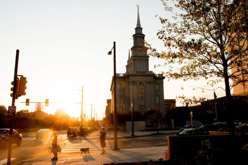 Jeremy Harmon  |  The Salt Lake Tribune  A couple walk their dogs near the Philadelphia Pennsylvania Temple on Wednesday, September 14,  2016.